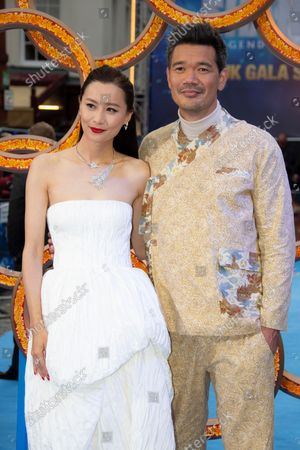 Stock Image of Director Destin Daniel Cretton, right and actor Fala Chen pose for photographs on the red carpet for the premiere of Shang-Chi and the Legend of the Ten Rings, the first Marvel film to feature an Asian superhero as the lead character, at a cinema in west London