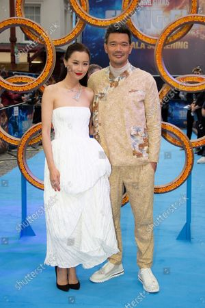 Director Destin Daniel Cretton, right and actor Fala Chen pose for photographs on the red carpet for the premiere of Shang-Chi and the Legend of the Ten Rings, the first Marvel film to feature an Asian superhero as the lead character, at a cinema in west London