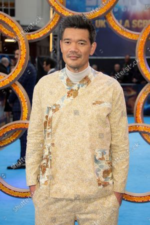 Director Destin Daniel Cretton, poses for photographs on the red carpet for the premiere of Shang-Chi and the Legend of the Ten Rings, the first Marvel film to feature an Asian superhero as the lead character, at a cinema in west London