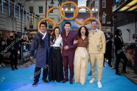 Actors from left to right Benedict Wong, Michelle Yeoh, Simu Liu, Sandra Oh and Director Destin Daniel Cretton, pose for photographs on the red carpet for the premiere of Shang-Chi and the Legend of the Ten Rings, the first Marvel film to feature an Asian superhero as the lead character, at a cinema in west London