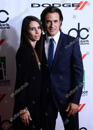 Actor Dermot Mulroney and his wife Tharita Catulle arrive on the red carpet for the 17th annual Hollywood Film Awards gala presented by the Los Angeles Times at the Beverly Hilton Hotel in Beverly Hills, California on October 21, 2013. The event honors excellence in the art of filmmaking as well as creative talent within the global community.