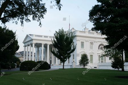 The American flag flies at half staff at the White House in Washington, DC. Multiple explosions near Hamid Karzai International Airport in Kabul, Afghanistan wounded many and killed at least 12 American service members.