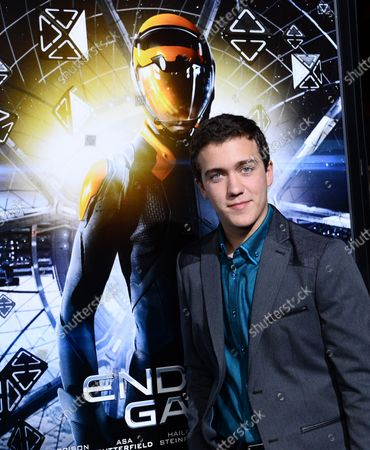 """Cast member Cameron Gaskins attends the premiere of the sci-fi motion picture """"Ender's Game"""" at TCL Chinese Theatre (formerly Grauman's) in the Hollywood section of Los Angeles on October 28, 2013. The film depicts the people of Earth banding together to prevent their own annihilation from the Buggers, a technologically superior alien species. The International Military seeks out a leader who can save the human race from the alien attack in a battle that will determine the future of Earth."""