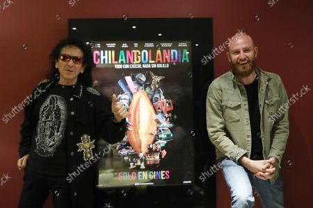 """Carlos Santos (R) and singer-songwriter Alex Lora (L) pose for a photo during a press conference for the movie """"Chilangolandia"""", in Mexico City, Mexico, 26 August 2021. The movie shows the experience of living a single day in the busy comings and goings of a megalopolis of more than 20 million people."""