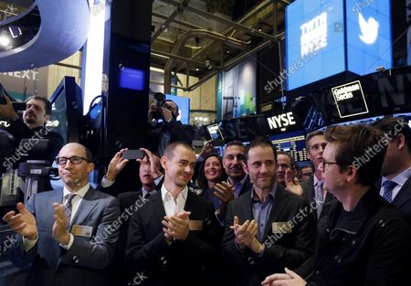 Twitter CEO Dick Costolo, Twitter co-founder Jack Dorsey, Twitter co-founder Evan Williams and Twitter co-founder Biz Stone react at the ringing of the opening bell before shares of Twitter are traded for the first time at the New York Stock Exchange on Wall Street In New York City on November 7, 2013. The NYSE Euronext staged a first-ever weekend test for the initial public offer two weeks ago to avoid reprising the problems with rival Nasdaq's systems that delayed timely orders and ruined Facebook's debut on Wall Street.