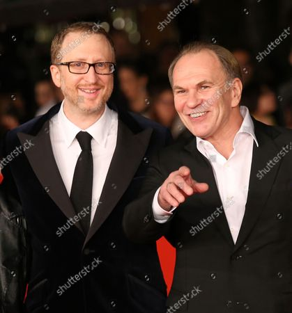 Jury President James Gray (L) and jury member Aleksei Guskov arrive on the red carpet during the opening of the 8th annual Rome International Film Festival in Rome on November 8, 2013.