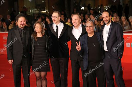 (From L to R) Jury members Zhang Yuan, Noemie Lvovsky, Jury President James Gray, Jury members Aleksei Guskov, Amir Naderi and Luca Guadagnino arrive on the red carpet during the opening of the 8th annual Rome International Film Festival in Rome on November 8, 2013.