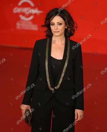 """Alessia Barela arrives on the red carpet before the screening of the film """"Il Venditore Di Medicine"""" during the 8th annual Rome International Film Festival in Rome on November 11, 2013."""