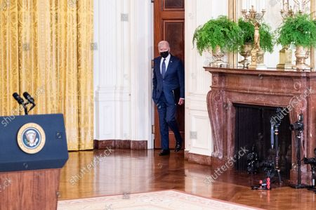 President Joe Biden walks into the White House East Room to speak about the terror attack at Hamid Karzai International Airport in Kabul, Afghanistan, and the U.S. service members and Afghan victims killed and wounded in the attack.