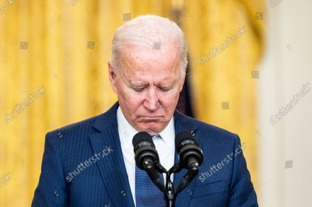 President Joe Biden observes a moment of silence for the victims in the terror attack at Hamid Karzai International Airport in Kabul, Afghanistan, for the U.S. service members and Afghan victims killed and wounded in the attack.