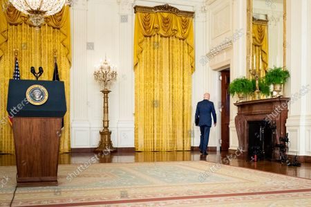 Stock Photo of President Joe Biden leaves the White House East Room after speaking about the terror attack at Hamid Karzai International Airport in Kabul, Afghanistan, and the U.S. service members and Afghan victims killed and wounded in the attack.
