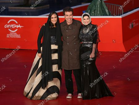 """Dana Keilani (L), Alessio Cremonini (C) and Sara El Debuch arrive on the red carpet before the screening of the film """"Border"""" during the 8th annual Rome International Film Festival in Rome on November 12, 2013."""