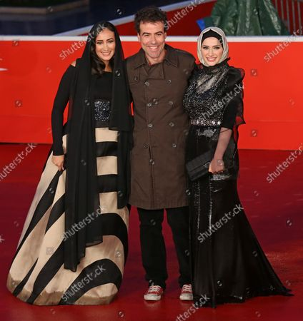 """Stock Photo of Dana Keilani (L), Alessio Cremonini (C) and Sara El Debuch arrive on the red carpet before the screening of the film """"Border"""" during the 8th annual Rome International Film Festival in Rome on November 12, 2013."""
