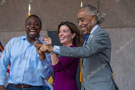 State Senator Brian Benjamin, New York State Governor Kathy Hochul and Reverend Al Sharpton celebrate at a press conference announcing State Senator Brian Benjamin as Lt. Governor in New York City.  Senator Benjamin, who placed fourth in the Democratic primary for city comptroller earlier this year, will replace Hochul who was sworn in as Governor this week after the resignation of former Governor Andrew Cuomo. Senator Benjamin has been a lead sponsor and advocate for criminal and police reforms that includes the Eric Garner Anti-Chokehold Act and the Less is More Act, which restricts the use of incarceration for non-criminal technical parole violations. He has also been a proponent of affordable housing.