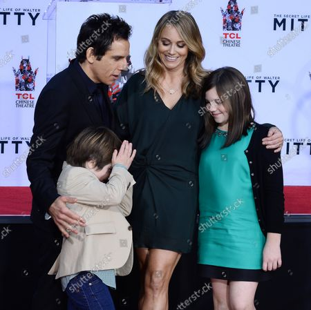 Quinlin Stiller (L), the son of actor Ben Stiller reacts to photographer's flashes as Stiller is joined by his wife, actress Christine Taylor and daughter Ella Stiller during his hand and footprint ceremony in the forecourt of the TCL Chinese Theatre (formerly Grauman's) in the Hollywood section of Los Angeles on December 3, 2013.