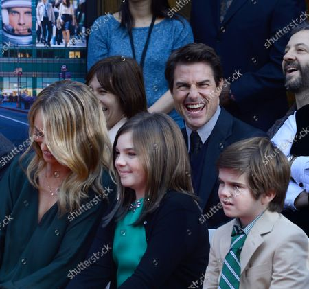 Actress Christine Taylor (L) and actor Tom Cruise, right rear, react with Ella Stiller C) and Quinlin Stiller during actor Ben Stiller's hand and footprint ceremony in the forecourt of the TCL Chinese Theatre (formerly Grauman's) in the Hollywood section of Los Angeles on December 3, 2013.