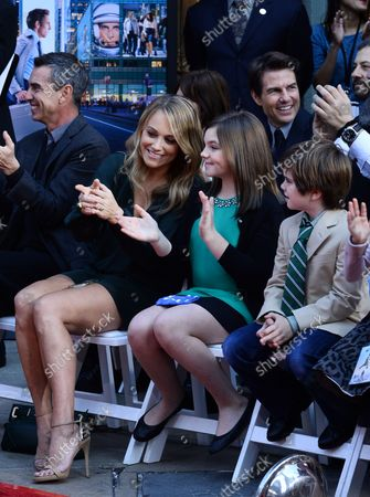 Actress Christine Taylor (L) and actor Tom Cruise, right rear, react with her daughter Ella Stiller C) and son Quinlin Stiller during actor Ben Stiller's hand and footprint ceremony in the forecourt of the TCL Chinese Theatre (formerly Grauman's) in the Hollywood section of Los Angeles on December 3, 2013.