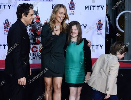 Quinlin Stiller (L), the son of actor Ben Stiller walks away from a photo-op after reacting to photographer's flashes as Stiller is joined by his wife, actress Christine Taylor and daughter Ella Stiller during his hand and footprint ceremony in the forecourt of the TCL Chinese Theatre (formerly Grauman's) in the Hollywood section of Los Angeles on December 3, 2013.