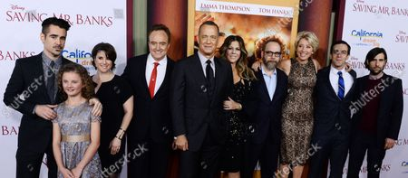 """Actors Colin Farrell, Annie Rose Buckley, Melanie Paxson, Bradley Whitford, Tom Hanks, Rita Wilson, Paul Giamatti, Emma Thompson, B.J. Novak and Jason Schwartzman (L-R) gather on the red carpet during the premiere of the biographical motion picture drama """"Saving Mr. Banks"""" , the untold backstory of how the classic film 'Mary Poppins' made it to the screen, at Walt Disney Studios in Burbank, California on December 9, 2013."""