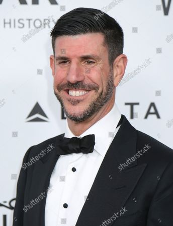 Rich Ross arrives on the red carpet during the 2013 amfAR Inspiration Gala at Milk Studios in Los Angeles on December 12, 2013.