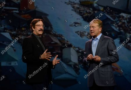 Stock Image of Rick Smolan, CEO of Against All Odds Productions, talks with Cisco Chairman and CEO John Chambers during his key note address at the 2014 International CES, a trade show of consumer electronics, in Las Vegas, Nevada on January 7, 2014.