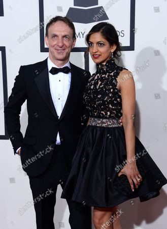 Composer Mychael Danna (L) and Aparna Danna arrive for the 56th annual Grammy Awards at Staples Center in Los Angeles on January 26, 2014.