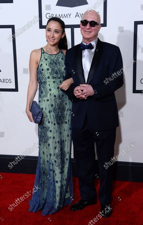 Stock Picture of Musician Paul Shaffer (R) and actress Victoria Lily Shaffer arrive for the 56th annual Grammy Awards at Staples Center in Los Angeles on January 26, 2014.