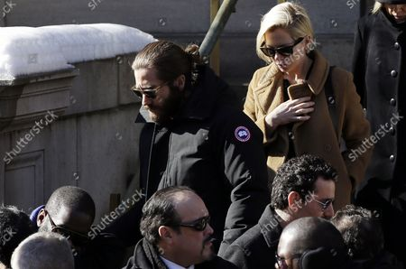 Michelle Williams exits the funeral of Philip Seymour Hoffman at St. Ignatius Church on Manhattan's Upper East Side in New York City on February 7, 2014. Hoffman, 46, was found dead Sunday of an apparent heroin overdose in his apartment. He leaves behind his partner of 15 years, Mimi O'Donnell, and their three children.