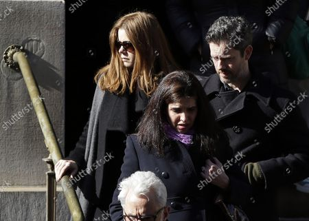 Amy Adams exits the funeral of Philip Seymour Hoffman at St. Ignatius Church on Manhattan's Upper East Side in New York City on February 7, 2014. Hoffman, 46, was found dead Sunday of an apparent heroin overdose in his apartment. He leaves behind his partner of 15 years, Mimi O'Donnell, and their three children.