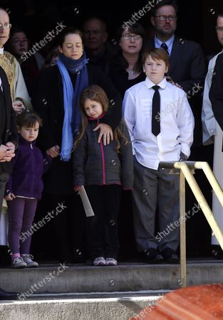 Mimi O'Donnell along with their children Willa Hoffman, Tallulah Hoffman and Cooper Hoffman watch the casket of Philip Seymour Hoffman as it is carried into the hearse at St. Ignatius Church on Manhattan's Upper East Side in New York City on February 7, 2014. Hoffman, 46, was found dead Sunday of an apparent heroin overdose in his apartment. He leaves behind his partner of 15 years, Mimi O'Donnell, and their three children.