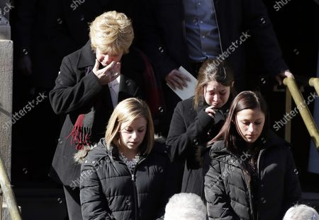 Mourners exit the funeral of Philip Seymour Hoffman at St. Ignatius Church on Manhattan's Upper East Side in New York City on February 7, 2014. Hoffman, 46, was found dead Sunday of an apparent heroin overdose in his apartment. He leaves behind his partner of 15 years, Mimi O'Donnell, and their three children.