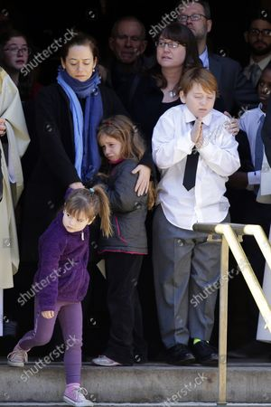 Mimi O'Donnell and the children of actor Philip Seymour Hoffman watch the casket of Philip Seymour Hoffman as it is carried into the hearse at St. Ignatius Church on Manhattan's Upper East Side in New York City on February 7, 2014. Hoffman, 46, was found dead Sunday of an apparent heroin overdose in his apartment. He leaves behind his partner of 15 years, Mimi O'Donnell, and their three children.