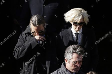 Joaquin Phoenix and Allie Teilz exit the funeral of Philip Seymour Hoffman at St. Ignatius Church on Manhattan's Upper East Side in New York City on February 7, 2014. Hoffman, 46, was found dead Sunday of an apparent heroin overdose in his apartment. He leaves behind his partner of 15 years, Mimi O'Donnell, and their three children.