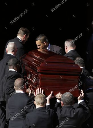 Pallbearers carry the casket containing the remains of actor Philip Seymour Hoffman up the stairs to his funeral at St. Ignatius Church on Manhattan's Upper East Side in New York City on February 7, 2014. Hoffman, 46, was found dead Sunday of an apparent heroin overdose in his apartment. He leaves behind his partner of 15 years, Mimi O'Donnell, and their three children.