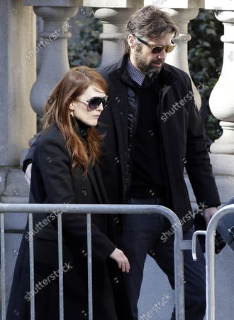 Julianne Moore enters the funeral of Philip Seymour Hoffman at St. Ignatius Church on Manhattan's Upper East Side in New York City on February 7, 2014. Hoffman, 46, was found dead Sunday of an apparent heroin overdose in his apartment. He leaves behind his partner of 15 years, Mimi O'Donnell, and their three children.