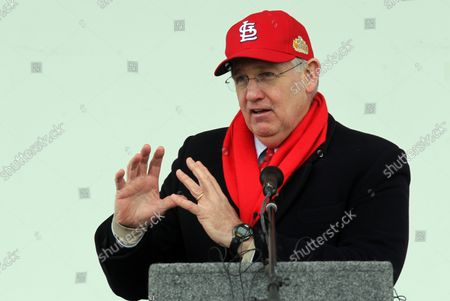 Wearing a St. Louis Cardinals cap, Missouri Governor Jay Nixon makes his remarks during dedication ceremonies for the Stan Musial Veterans Memorial Bridge over the Mississippi River on February 8, 2014. The Musial Bridge, named for the late St. Louis Cardinals and National Baseball Hall of Fame member Stan Musial, is a 2,803 foot-long,400 foot-high cable-stayed bridge connecting Missouri to Illinois.