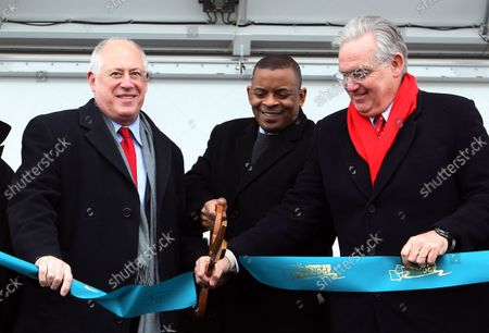 Missouri Governor Jay Nixon (R) and Illinois Governor Pat Quinn (L) help Secretary of Transportation Anthony Foxx cut the ribbon during dedication ceremonies for the Stan Musial Veterans Memorial Bridge  over the Mississippi River on February 8, 2014. The Musial Bridge, named for the late St. Louis Cardinals and National Baseball Hall of Fame member Stan Musial, is a 2,803 foot-long,400 foot-high cable-stayed bridge connecting Missouri to Illinois.