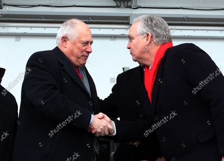Missouri Governor Jay Nixon (R) and Illinois Governor Pat Quinn shake hands after cutting  the ribbon dedicating the Stan Musial Veterans Memorial Bridge  over the Mississippi River on February 8, 2014. The Musial Bridge, named for the late St. Louis Cardinals and National Baseball Hall of Fame member Stan Musial, is a 2,803 foot-long,400 foot-high cable-stayed bridge connecting Missouri to Illinois.