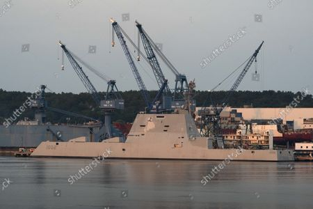 Stock Photo of The USS Lyndon B. Johnson is docked at Bath Iron Works on the Kennebec River, in Bath, Maine. The stealth destroyer is the last of three Zumwalt-class ships built by BIW