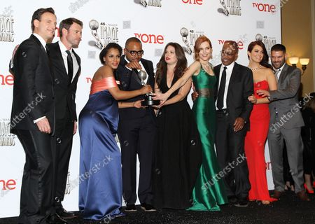 """(L-R) Actors Tony Goldwyn, Scott Foley, Kerry Washington, Columbus Short, Katie Lowes, Darby Stanchfield, Joe Morton, Bellamy Young, and Guillermo Diaz, hold the award they won for Outstanding Television Drama Series for """"Scandal"""", backstage at the 45th NAACP Image Awards at the Pasadena Civic Auditorium in Pasadena, California on February 22, 2014. The NAACP Image Awards celebrates the accomplishments of people of color in the fields of television, music, literature and film and also honors individuals or groups who promote social justice through creative endeavors."""