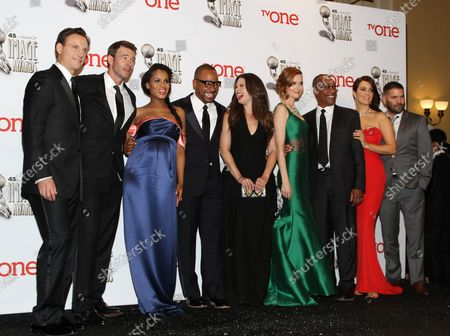 """(L-R) Actors Tony Goldwyn, Scott Foley, Kerry Washington, Columbus Short, Katie Lowes, Darby Stanchfield, Joe Morton, Bellamy Young, and Guillermo Diaz, winners of the Outstanding Drama Series award for """"Scandal"""", appear backstage at the 45th NAACP Image Awards at the Pasadena Civic Auditorium in Pasadena, California on February 22, 2014. The NAACP Image Awards celebrates the accomplishments of people of color in the fields of television, music, literature and film and also honors individuals or groups who promote social justice through creative endeavors."""