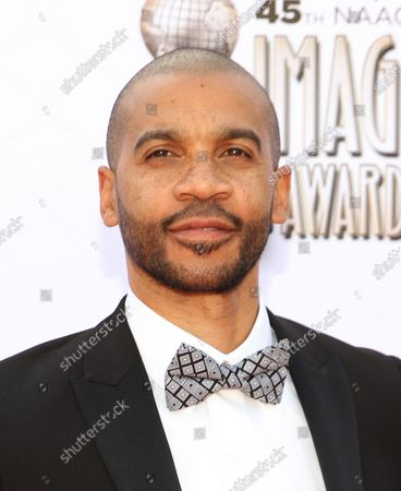 Actor Aaron D. Spears arrives for the 45th NAACP Image Awards at the Pasadena Civic Auditorium in Pasadena, California on February 22, 2014. The NAACP Image Awards celebrates the accomplishments of people of color in the fields of television, music, literature and film and also honors individuals or groups who promote social justice through creative endeavors.