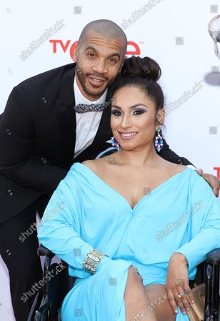 Actor Aaron D. Spears (L) and guest arrive for the 45th NAACP Image Awards at the Pasadena Civic Auditorium in Pasadena, California on February 22, 2014. The NAACP Image Awards celebrates the accomplishments of people of color in the fields of television, music, literature and film and also honors individuals or groups who promote social justice through creative endeavors.