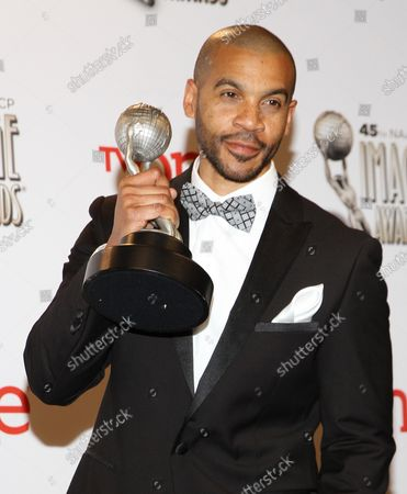 """Actor Aaron D. Spears holds the award he won for Outstanding Actor in a Daytime Drama Series - """"The Bold and the Beautiful"""" backstage at the 45th NAACP Image Awards at the Pasadena Civic Auditorium in Pasadena, California on February 22, 2014. The NAACP Image Awards celebrates the accomplishments of people of color in the fields of television, music, literature and film and also honors individuals or groups who promote social justice through creative endeavors."""