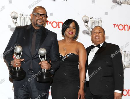 (L-R) Actor Forest Whitaker, winner of the Outstanding Actor in a Motion Picture award for 'Lee Daniels' The Butler' and the NAACP Chairman's Award, NAACP Board of Directors Chairman Roslyn Brock, and NAACP Board of Directors Vice Chairman Leon Russell appear backstage at the 45th NAACP Image Awards at the Pasadena Civic Auditorium in Pasadena, California on February 22, 2014. The NAACP Image Awards celebrates the accomplishments of people of color in the fields of television, music, literature and film and also honors individuals or groups who promote social justice through creative endeavors.