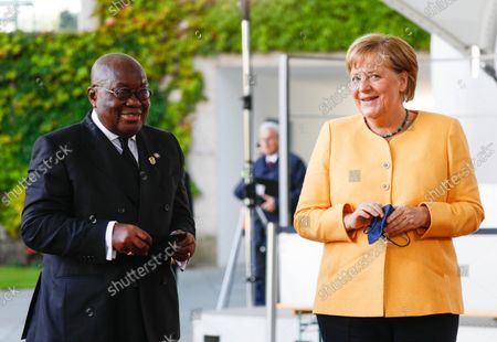 German Chancellor Angela Merkel (R) welcomes President of Ghana Nana Akufo-Addo (L) at the Chancellery for the G20 Compact with Africa summit, in Berlin, Germany, 27 August 2021.
