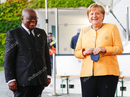 Stock Photo of German Chancellor Angela Merkel (R) welcomes President of Ghana Nana Akufo-Addo (L) at the Chancellery for the G20 Compact with Africa summit, in Berlin, Germany, 27 August 2021.