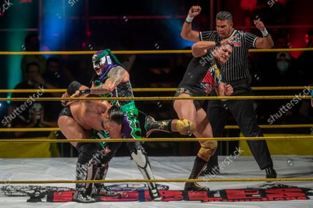 Stock Picture of Wrestlers Alberto Del Rio, Penta Joker and Texano Jr. in action during the wrestling show 'Hecho en México' by Patron Robles Promotions at Pepsi Center.