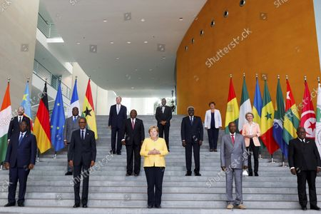 The participants of the G20 meeting on the Compact with Africa (CwA) pose for the group photo at the Chancellery in Berlin, . Back row from left, David Malpass, President of the World Bank, Akinwumi Adesina, President of the African Development Bank, Kristalina Georgieva, Director of the International Monetary Fund (IMF), center from left, Charles Michel, President of the EU Council, Felix Tshisekedi, President of the Democratic Republic of Congo, South African President Cyril Ramaphosa, Chair of the African Union (AU) Commission, Moussa Faki, EU Commission President Ursula von der Leyen, and front row from left, Senegalese President Macky Sall, Paul Kagama, President of Rwanda, German Chancellor Angela Merkel (CDU), Guinean President Alpha Conde, Ghanaian President Nana Akufo-Addo