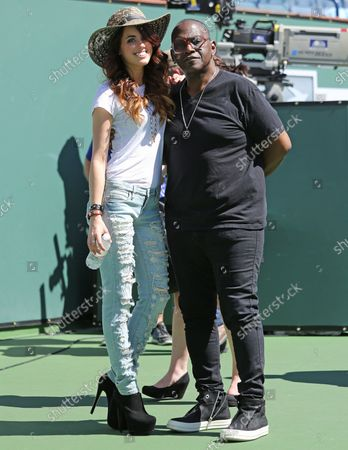 Stock Picture of Angie Miller (L) and Randy Jackson arrive on the court during the BNP Paribas Open in Indian Wells, California on March 16, 2014.  Pennetta defeated Radwanska 6-2, 6-1 to win the tournament.